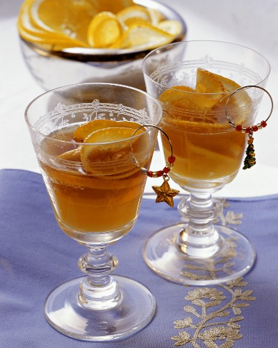 Two sherry cocktails with orange as aperitif