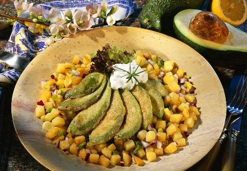 Deep-fried avocado slices on diced potatoes