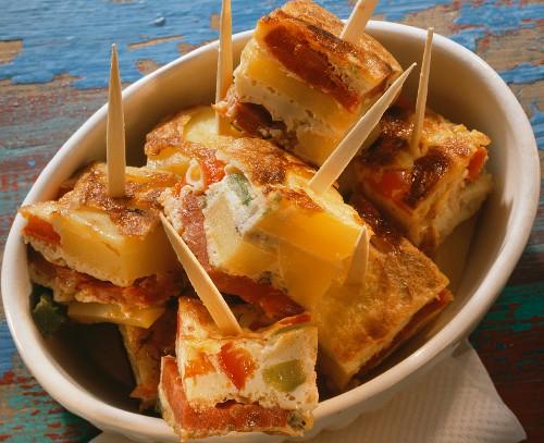 Cubes of vegetable tortilla on skewers