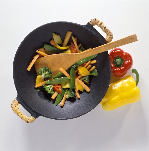 Vegetables in wok with bast-wrapped handles