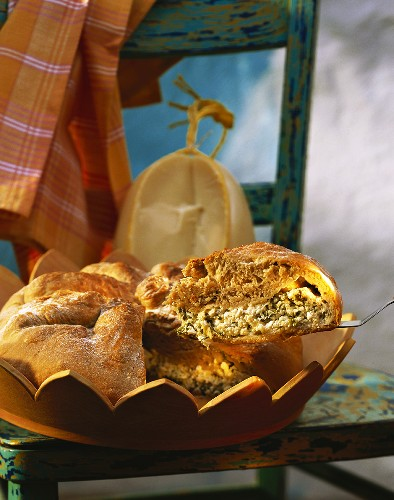 Khachapuri - cheese bread in wooden mould and on cake slice