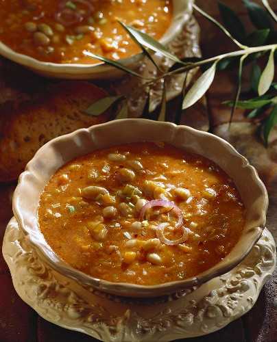 Bean soup with onions in a soup dish