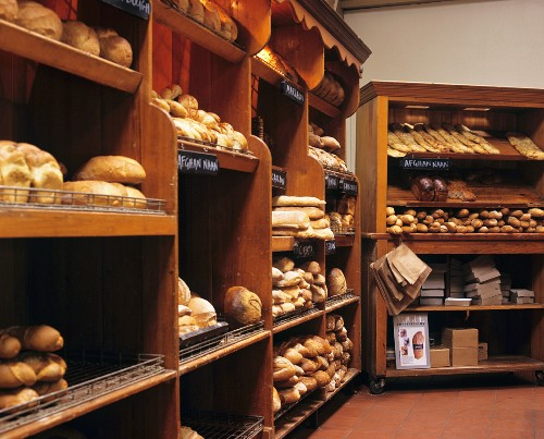 Various baked goods on shelves in Australian bakery