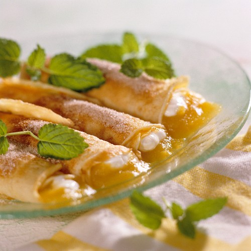 Pancake rolls with apricot puree and lemon balm