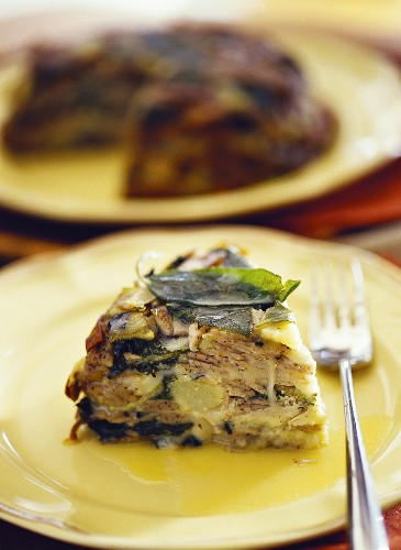 A piece of pasta cake (pizzoccheri) with chard & sage