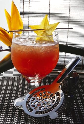 Plum wine aperitif with carambola; bar spoon