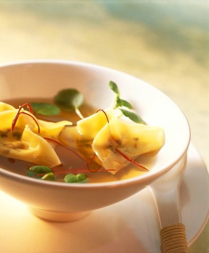Wan tan soup with strips of chili and watercress