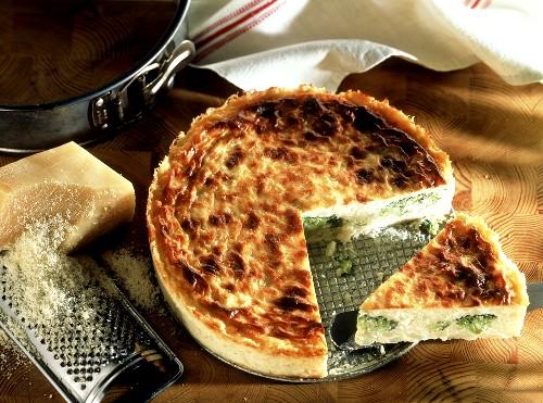 Cauliflower tart with cheese (a piece cut)