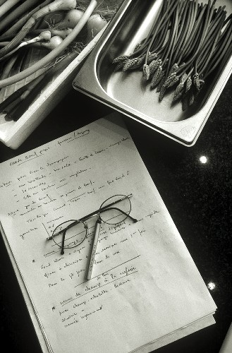 Still life with vegetables, recipe, spectacles and pencil
