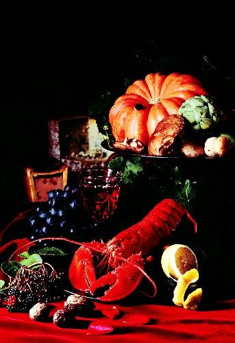 Still life with lobster, pumpkin, mushrooms and fruit