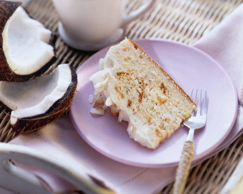 Piece of cloud cake with cream and grated coconut