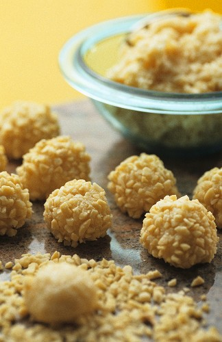 Coconut balls with chopped nuts