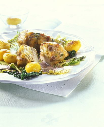 Stuffed pheasant breast with roast potatoes and savoy