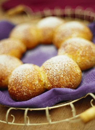 Sweet bread roll ring with icing sugar