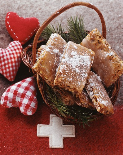 Basler Leckerli (Swiss cookies) on fir branches in basket