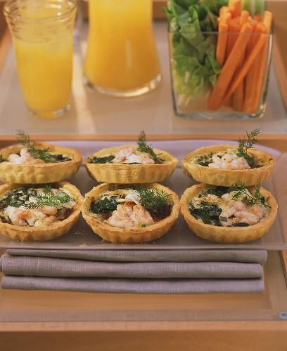 Shrimp quiches for fitness brunch; raw vegetables; fruit juice