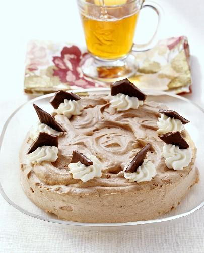 Peppermint gateau with chocolate mint cream; glass of tea