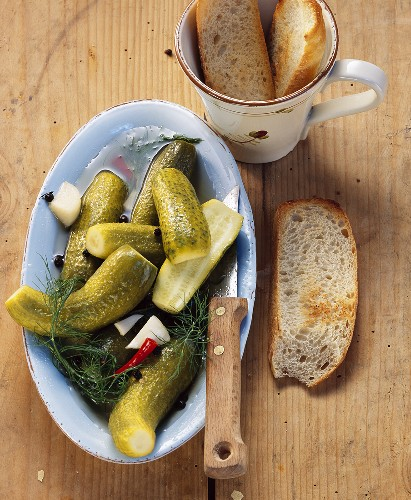 Pickled cucumbers with slices of white bread