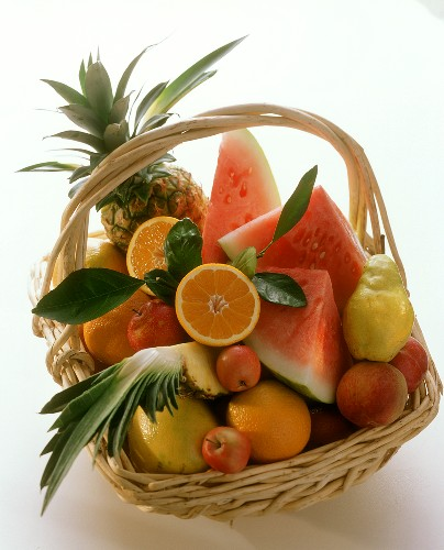 Basket of fruit, whole and cut into