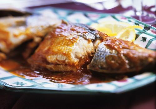 Sea bream with spicy sauce (Algeria)