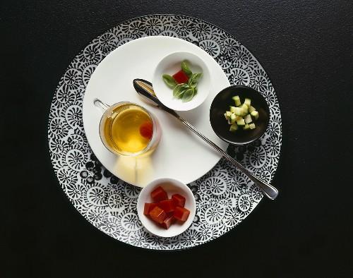 White tomato bouillon with various ingredients