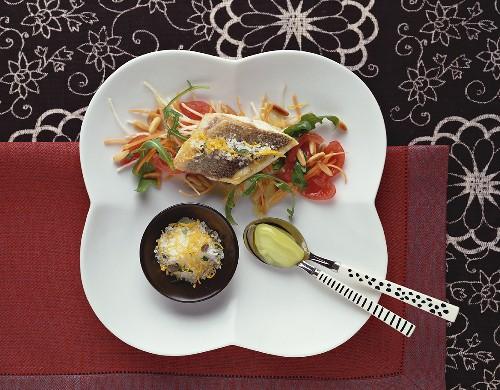 Branzino on vegetables with lemon salt & frozen olive oil