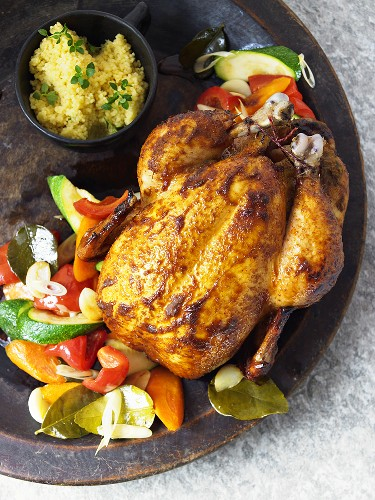 Corn-fed chicken with vegetables and couscous
