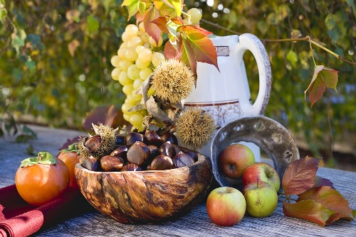 Sweet chestnuts, grapes, persimmons, apples & autumn leaves