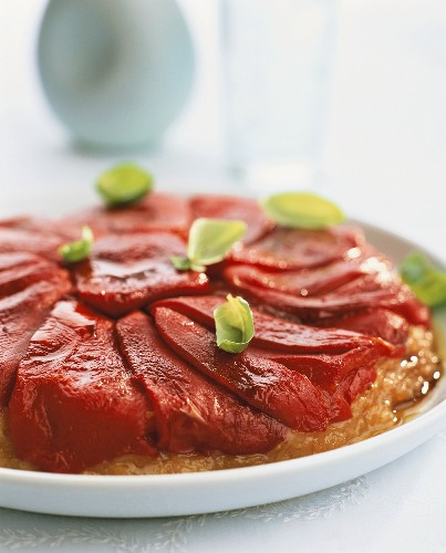 Red pepper tart with basil leaves