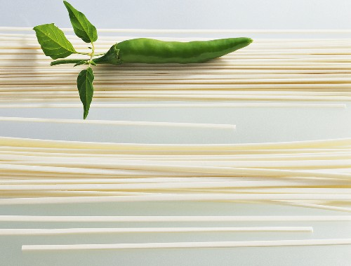 Two types of Chinese noodles with green chili pepper
