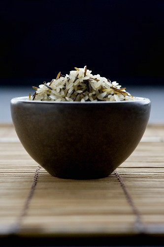 Long-grain rice with wild rice in brown bowl