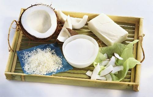 Coconut, grated coconut, coconut milk, coconut fat on tray