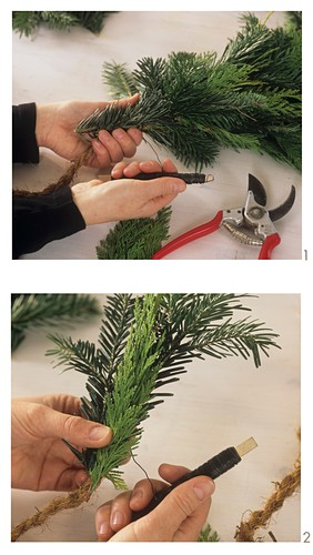 Making a garland of conifer greenery