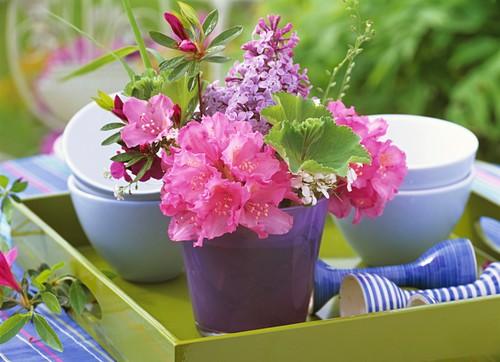 Tray with small posy (Azalea, lilac) and crockery