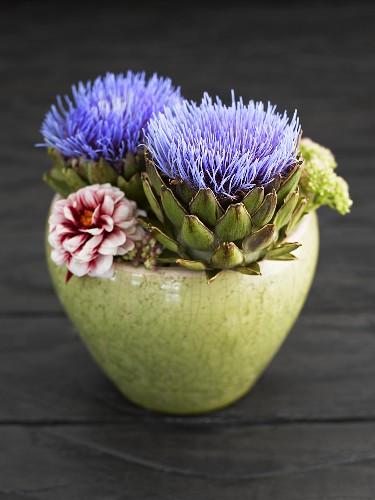 Artichoke flowers in bowl of flowers