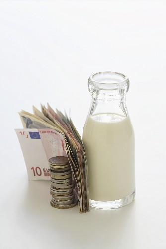 Bottle of milk and money