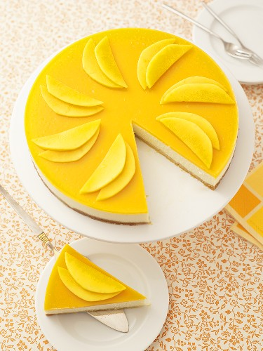 Mango cheesecake, a piece removed