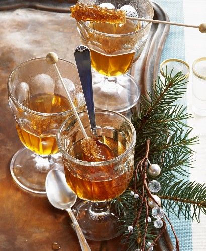 Jagertee (tea with rum) with sugar swizzle sticks