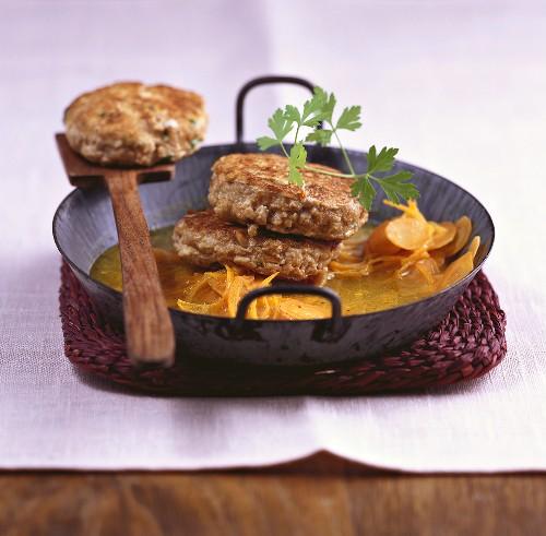 Tofu and walnut burgers with carrots