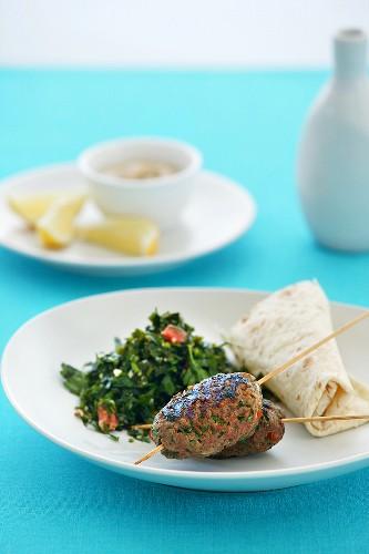 Minced lamb skewers with accompaniments (Lebanon)