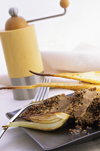 Pork fillet with mustard and sesame crust and fennel