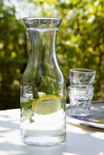 Carafe of water with lemon and mint