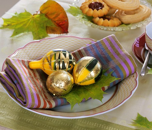 Ornamental gourds with gold leaf (table decoration)