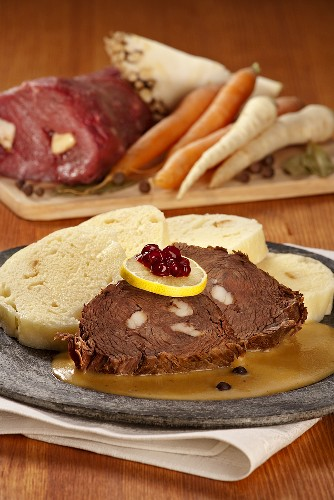 Beef studded with fat, with dumplings and cream sauce (Czech Republic)