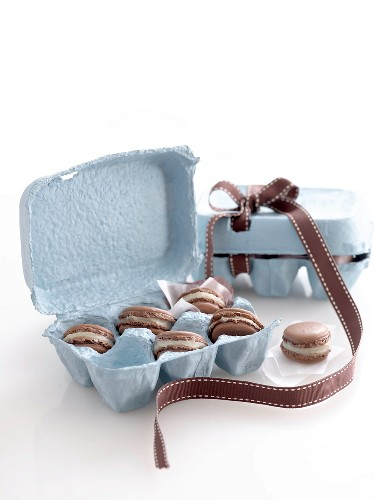 Chocolate almond macarons in egg box