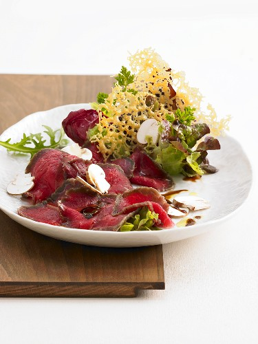 Salt beef with button mushrooms and Parmesan crisps