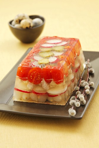 Chicken, cherry tomatoes, radishes and pearl onions in aspic