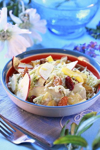 Chinese cabbage salad with peach slices and raisins