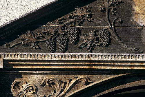 Wood carving of a vine on door arch, Jidvei Castle, Romania