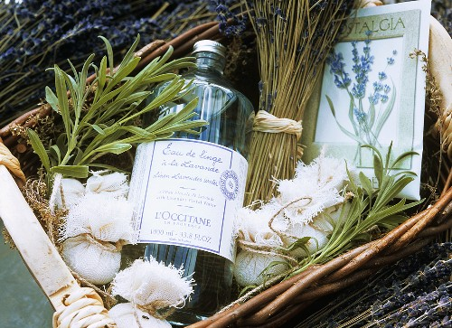 Lavender water, scented bags and dried lavender in basket